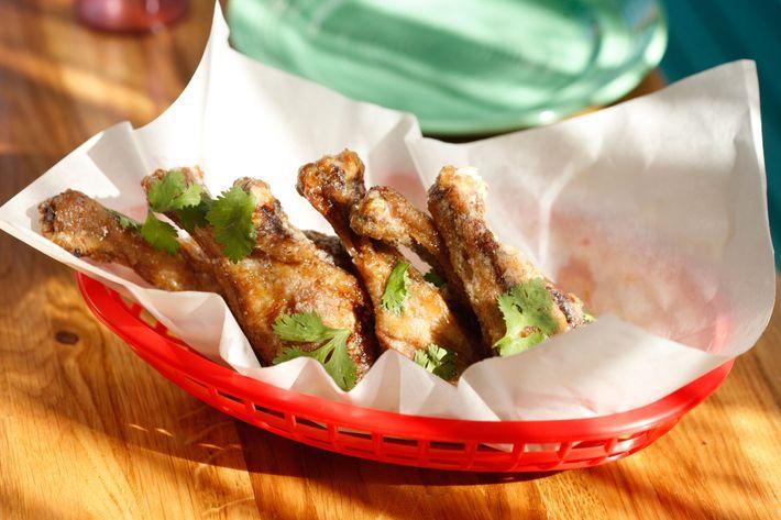 Twice-cooked duck wings with smoked-habanero honey.