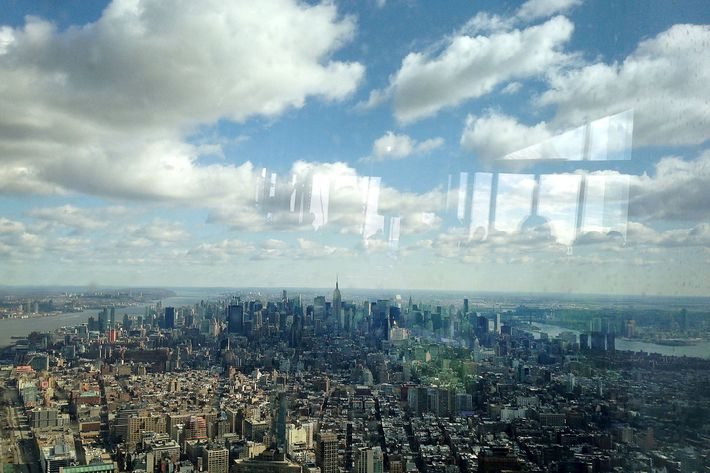 "The Manhattan skyline is seen from the One World Trade Center observation deck in New York, U.S., on Tuesday, April 2, 2013. The observation deck at One World Trade Center, expected to open in 2015, will occupy the tower's 100th through 102nd floors. Guests visiting the observation deck will see a ""pre-show"" about the creation of the building while waiting in line in the lobby."