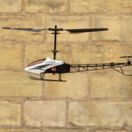 LONDON, ENGLAND - OCTOBER 28:  Seven-year-old Drew, plays with a remote controlled helicopter made by Bladez Toys at the 'Dream Toys' fair of predicted top selling toys for Christmas on October 28, 2009 in London, England. The Toy Retailers Association have announced their annual list of 12 toys priced under 50 GBP which are likely to sell well in the run up to Christmas.  (Photo by Oli Scarff/Getty Images)