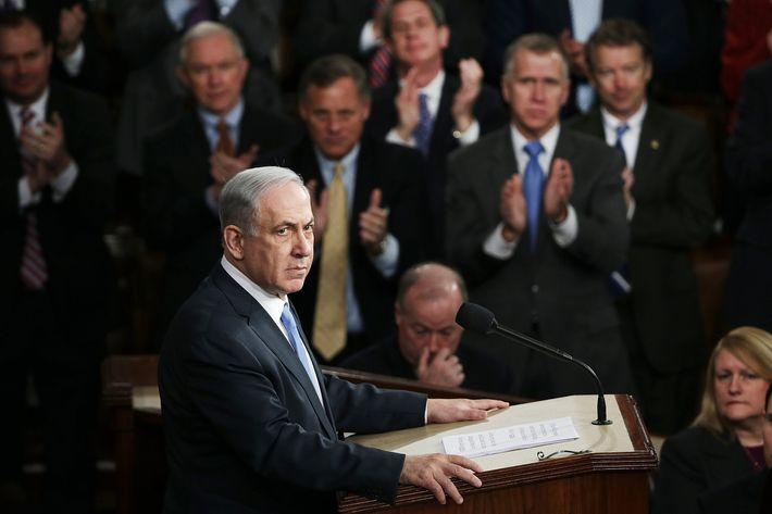 """Israeli Prime Minister Benjamin Netanyahu addresses a joint meeting of the United States Congress in the House chamber at the U.S. Capitol March 3, 2015 in Washington, DC. During his speech, Netanyah said, """"Today the Jewish people face yet another attempt by another Persian potentate to destroy us."""" (Photo by Win McNamee/Getty Images)"""