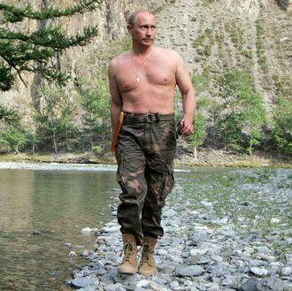 Russian President Vladimir Putin walking in the Khemchik River.