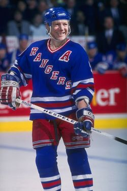 1993-1994:  Leftwinger Adam Graves of the New York Rangers looks on during a game against the Montreal Canadiens at the Montreeal Forum in Montreal, Quebec.  Mandatory Credit: Robert Laberge  /Allsport
