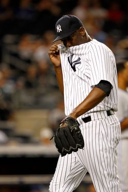 NEW YORK - AUGUST 27:  Rafael Soriano #29 of the New York Yankees reacts after giving up a three-run home run to Colby Rasmus #28 of the Toronto Blue Jays  at Yankee Stadium on August 27, 2012 in New York City.  (Photo by Jeff Zelevansky/Getty Images)