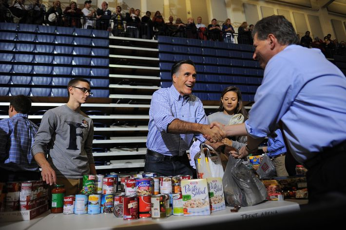 US Republican presidential candidate Mitt Romney helps collect and pack donated goods as he attends a storm relief campaign event to help people who suffered from storm Sandy, in Kettering, Ohio, on October 30, 2012. The death toll from superstorm Sandy has risen to 32 in the mainland United States and Canada, and was expected to climb further as several people were still missing, officials said. Officials in the US states of Connecticut, New York, New Jersey, Maryland, Pennsylvania, West Virginia and North Carolina all reported deaths from the massive storm system, while Toronto police said a Canadian woman was killed by flying debris.