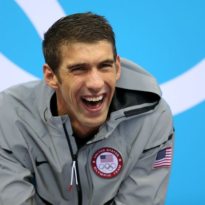 Gold Medallist Michaell Phelps of the United States smiles prior to receiving his medal on the podium during the medal ceremony for the Men's 4 x 200m Freestyle Relay final on Day 4 of the London 2012 Olympic Games at the Aquatics Centre on July 31, 2012 in London, England.