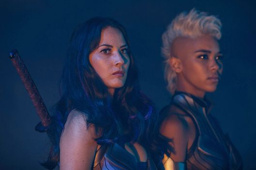 DF-13452 – Psylocke (Olivia Munn, left) and Storm (Alexandra Shipp) are two of Apocalypse's Four Horsemen. Photo Credit: Alan Markfield.