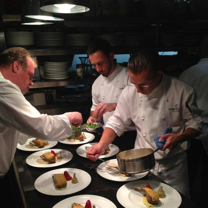 Elena, left, plates a meal in the kitchen at Chefs Club Aspen.