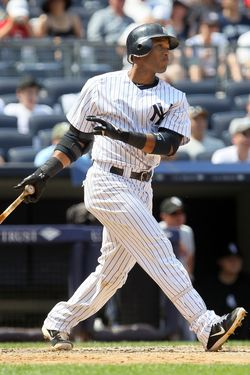 NEW YORK, NY - JULY 01:  Robinson Cano #24 of the New York Yankees follows through on his third inning two-run home run against the Chicago White Sox at Yankee Stadium on July 1, 2012  in the Bronx borough of New York City.  (Photo by Jim McIsaac/Getty Images)