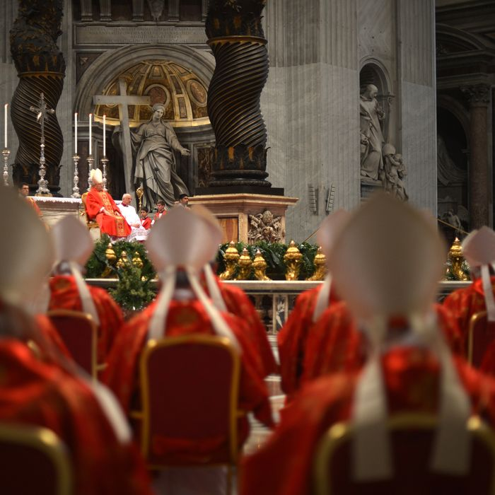 Dean of the College of Cardinals Angelo Sodano (L) leads a mass at the St Peter's basilica on March 12, 2013 at the Vatican. Cardinals moved into the Vatican today as the suspense mounted ahead of a secret papal election with no clear frontrunner to steer the Catholic world through troubled waters after Benedict XVI's historic resignation.The 115 cardinal electors who pick the next leader of 1.2 billion Catholics in a conclave in the Sistine Chapel will live inside the Vatican walls completely cut off from the outside world until they have made their choice.
