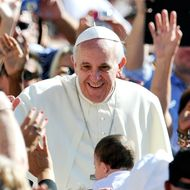 Pope Francis arrives for his general audience in St Peter's square at the Vatican on September 18, 2013 .