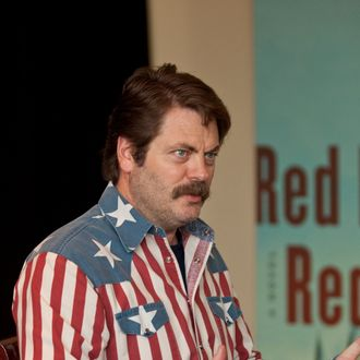 VANCOUVER, BC - NOVEMBER 03: Actor Nick Offerman signs copies of his new book