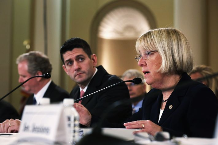 U.S. Sen. Patty Murray (D-WA) (R) speaks as Rep. Paul Ryan (R-WI) (L) listens during a Conference on the FY2014 Budget Resolution meeting November 13, 2013 on Capitol Hill in Washington, DC. Congressional Budget Office Director Doug Elmendorf briefed the conferees on CBO's budget and economic outlook.