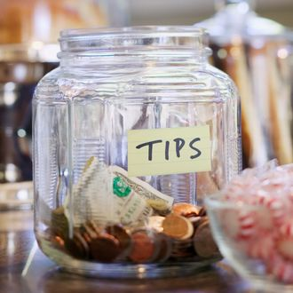 Tip Jar on Store Counter --- Image by ? Rick Gayle Studio/Corbis