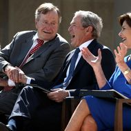 DALLAS, TX - APRIL 25:  Former U.S. President George W. Bush (3rd L) shaks hands with his father  former President George H.W. Bush (2nd L) as they attend the opening ceremony of the George W. Bush Presidential Center with his wife, former first lady Laura Bush (R), and his mother, former first lady Barbara Bush (L), April 25, 2013 in Dallas, Texas. The Bush library, which is located on the campus of Southern Methodist University, with more than 70 million pages of paper records, 43,000 artifacts, 200 million emails and four million digital photographs, will be opened to the public on May 1, 2013. The library is the 13th presidential library in the National Archives and Records Administration system.  (Photo by Alex Wong/Getty Images)