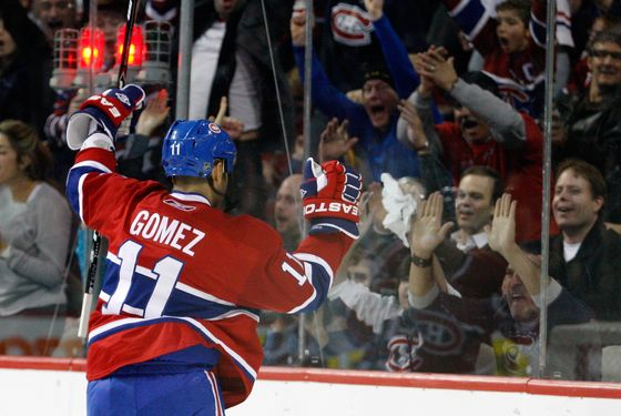 MONTREAL, CANADA - FEBRUARY 5:  Scott Gomez #11 of the Montreal Canadiens celebrates his second period goal during the NHL game against the New York Rangers at the Bell Centre on February 5, 2011 in Montreal, Quebec, Canada.  (Photo by Richard Wolowicz/Getty Images) *** Local Caption *** Scott Gomez