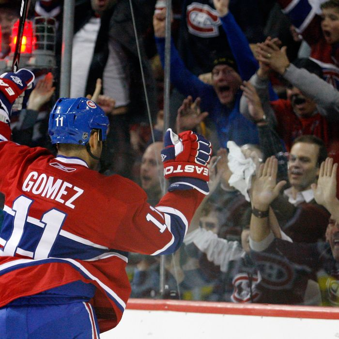 Scott Gomez #11 of the Montreal Canadiens celebrates his second period goal during the NHL game against the New York Rangers