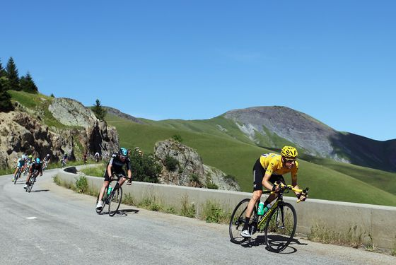 LA TOUSSUIRE, FRANCE - JULY 12:  Race leader Bradley Wiggins of Great Britain leads team mate Christopher Froome of Great Britain and on stage eleven of the 2012 Tour de France from Albertville to La Toussuire on July 12, 2012 in La Toussuire, France.  (Photo by Bryn Lennon/Getty Images)