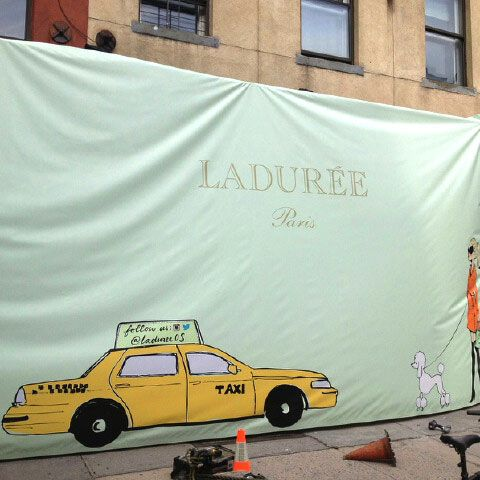 This façade went up on West Broadway this morning.
