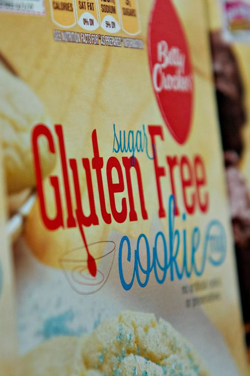 """Gluten Free"" appears on the packaging for General Mills Inc. Betty Crocker brand cookie mix displayed for sale at a supermarket in Princeton, Illinois, U.S., on Wednesday, Aug. 7, 2013. The Food and Drug Administration (FDA) is issuing a final rule to define the term ""gluten-free"" when voluntarily used in food labeling, according to a notice published in the Aug. 5 Federal Register. Photographer: Daniel Acker/Bloomberg via Getty Images"