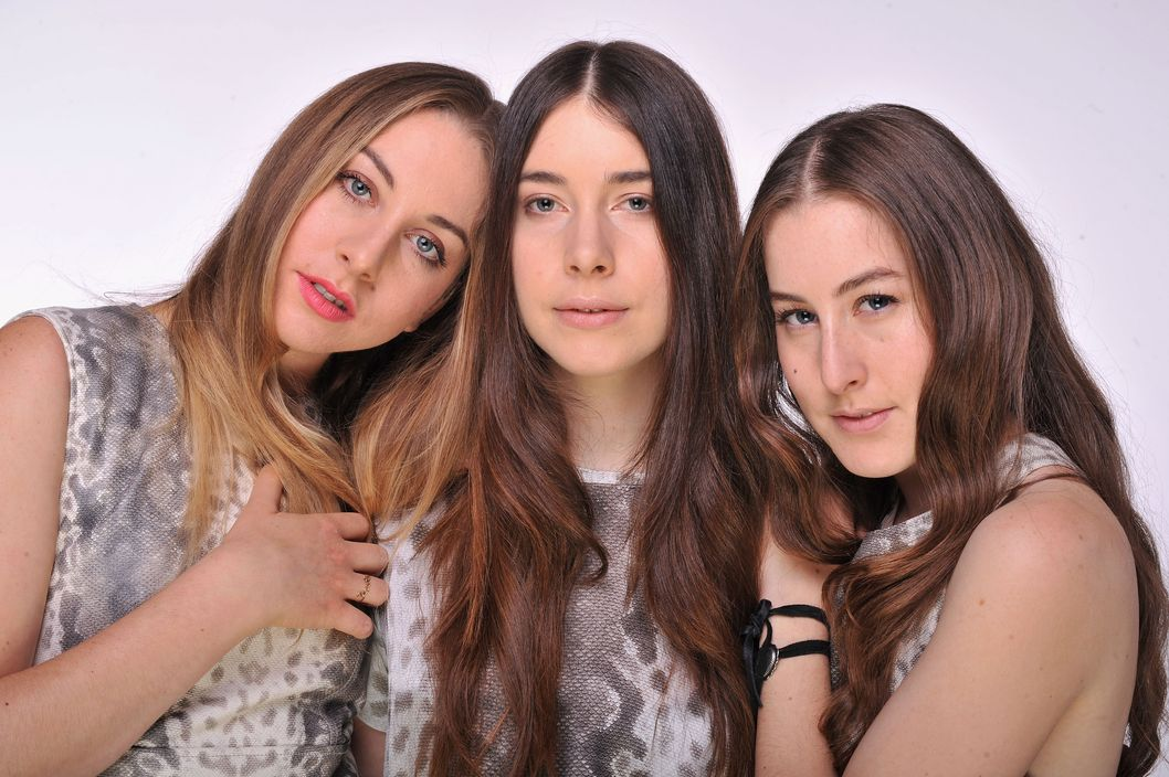 "LONDON, ENGLAND - JUNE 01:  (EXCLUSIVE COVERAGE. HIGHER RATES APPLY) (L-R) Alana Haim, Danielle Haim and Este Haim of HAIM pose for a portrait backstage at the ""Chime For Change: The Sound Of Change Live"" Concert at Twickenham Stadium on June 1, 2013 in London, England. Chime For Change is a global campaign for girls' and women's empowerment founded by Gucci with a founding committee comprised of Gucci Creative Director Frida Giannini, Salma Hayek Pinault and Beyonce Knowles-Carter.  (Photo by Mick Hutson/Chime For Change/Getty Images for Gucci)"