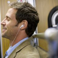 Man listening to music in subway, Munich, Bavaria, Germany