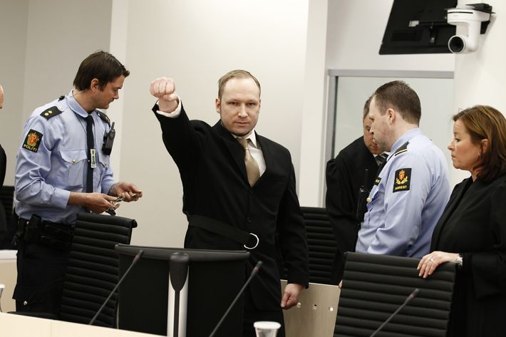 Rightwing extremist Anders Behring Breivik, who killed 77 people in twin attacks in Norway last year, makes a farright salute as he enters court on April 16, 2012, for his trial which begins today. Right-wing extremist Anders Behring Breivik made a farright salute as he entered the Oslo district courtroom Monday, where he goes on trial for killing 77 people in twin attacks last July.