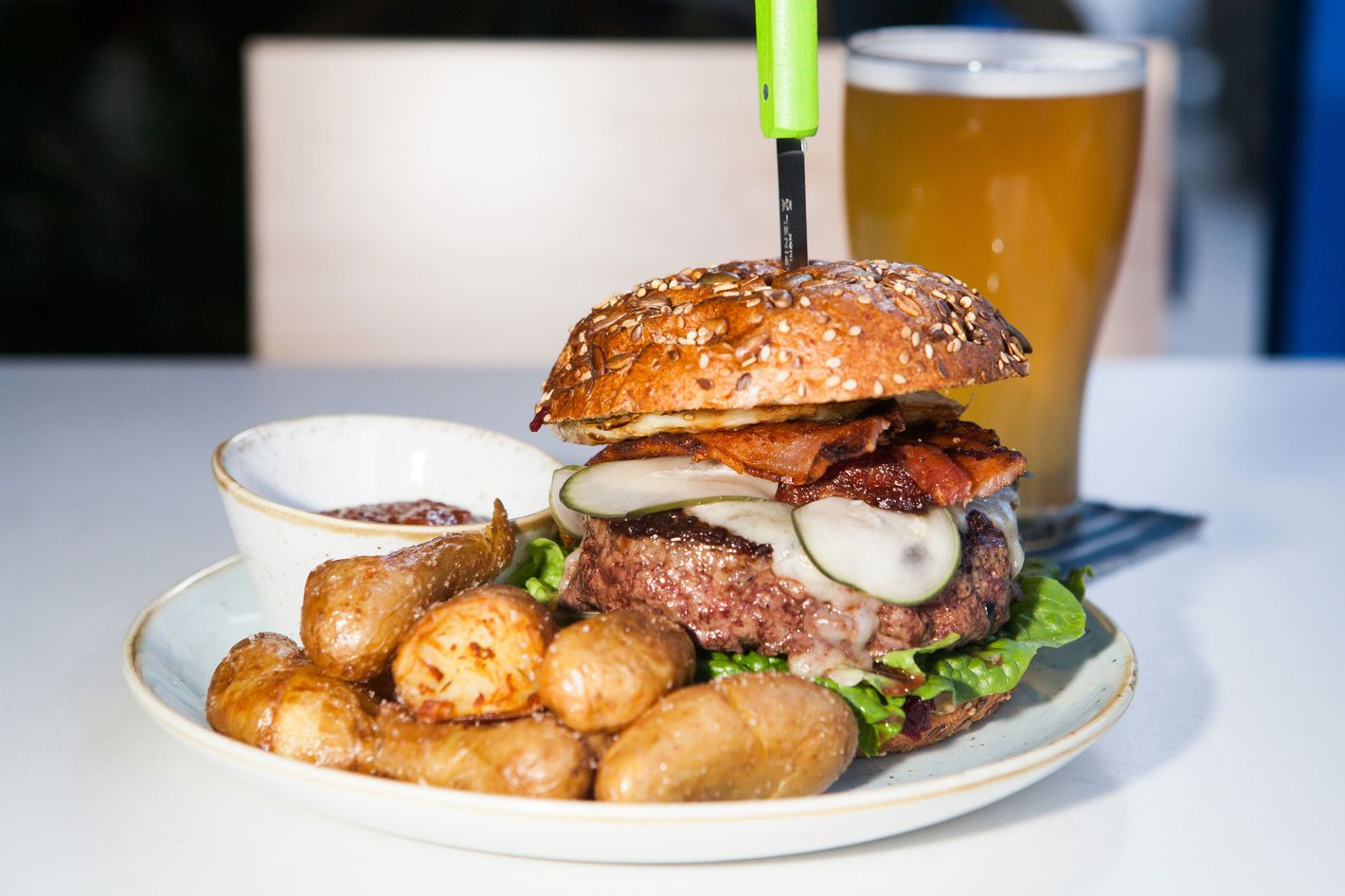 The Two Hands beef burger, with crispy potatoes and housemade ketchup (avocado and bacon are optional).