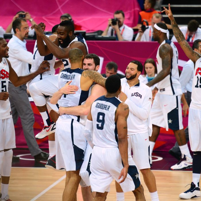 US players celebrate after the London 2012 Olympic Games men's gold medal basketball game between USA and Spain at the North Greenwich Arena in London on August 12, 2012.