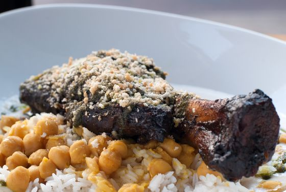 Lamb Bowl with coconut-ginger sauce, white rice, chickpeas, braised lamb shank, chadon beni chimichurri, and panko.