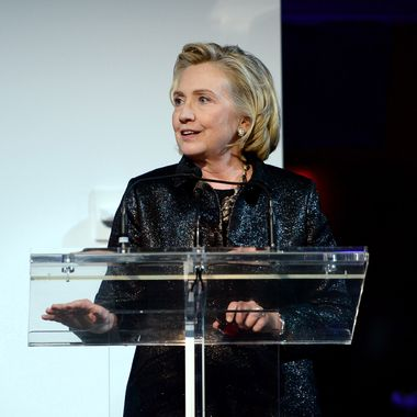 NEW YORK, NY - OCTOBER 16:  (L-R) Hillary Rodham Clinton, recipient of the Michael Kors Award for Outstanding Community Service, speaks onstage at God's Love We Deliver 2013 Golden Heart Awards Celebration at Spring Studios on October 16, 2013 in New York City.  (Photo by Dimitrios Kambouris/Getty Images for Michael Kors)