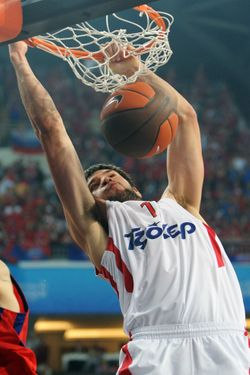Olympiacos Piraeus' Kostas Papanikolaou (R) scores against CSKA during the Euroleague Final four basketball final match CSKA Moscow vs Olympiakos Piraeus at the Sinan Erdem Arena in Istanbul on May 13, 2012. Olympicos won 62-61. AFP PHOTO/ BULENT KILIC        (Photo credit should read BULENT KILIC/AFP/GettyImages)