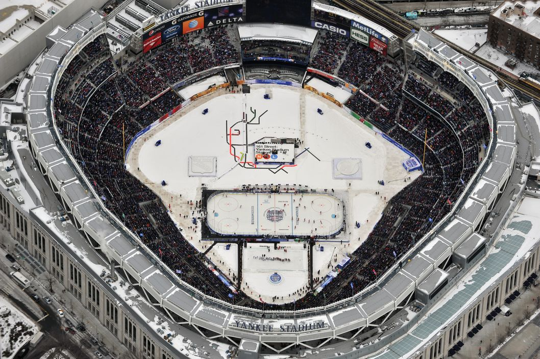 NEW YORK, NY - JANUARY 26:  (EDITORIAL USE ONLY) Aerial view of the 2014 Coors Light NHL Stadium Series between the New York Rangers and the New Jersey Devils at Yankee Stadium on January 26, 2014 in the Bronx borough of New York City.  (Photo by LI-Aerial/Getty Images)