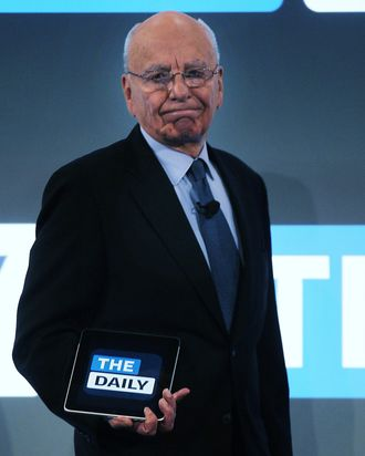 NEW YORK, NY - FEBRUARY 02: News Corp. CEO Rupert Murdoch walks on stage with an iPad for the launch of his new online newspaper for the Apple iPad called The Daily on February 2, 2011 at the Guggenheim Museum in New York City. The new media product is owned by News Corp. and will be sold for 14 cents a day. (Photo by Spencer Platt/Getty Images) *** Local Caption *** Rupert Murdoch