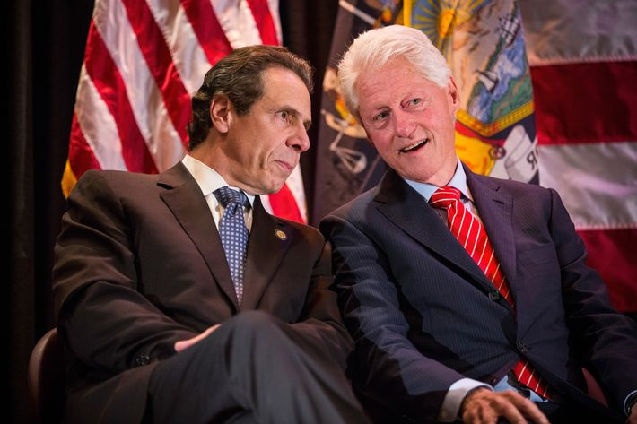 Former U.S. President Bill Clinton (R) speaks with New York State governor Andrew Cuomo (L) at a campaign event to support Cuomo's reelection October 30, 2014 in New York City. Citizens go to the polls next Tuesday, November 4.