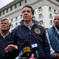 New York Governor Andrew Cuomo (C) speaks to members of the media about recovering efforts after Hurricane Sandy, on October 31, 2012 in Long Beach, New York. Businesses across the eastern seaboard are attempting to return to normal operations as clean-up from Hurricane Sandy continues.