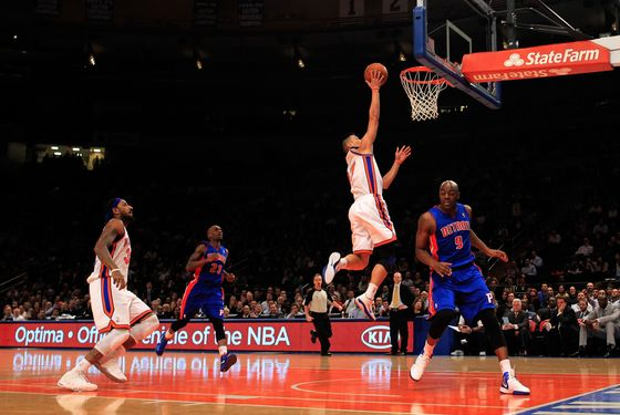 NEW YORK, NY - JANUARY 31:  Jeremy Lin #17 of the New York Knicks lays the ball up over Damien Wilkins #9 of the Detroit Pistons at Madison Square Garden on January 31, 2012 in New York City.  NOTE TO USER: User expressly acknowledges and agrees that, by downloading and or using this photograph, User is consenting to the terms and conditions of the Getty Images License Agreement. (Photo by Chris Trotman/Getty Images)