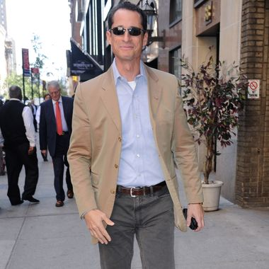 Former U.S. Representative Anthony Weiner walks in Midtown Manhattan on October 5, 2011 in New York City.