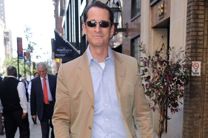 Former U.S. Representative Anthony Weiner walks in Midtown Manhattan on October 5, 2011 in New York City.