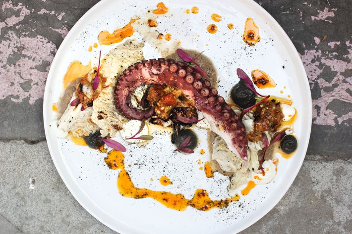Octopus with grilled savoy cabbage, lentil masabacha, greek yogurt, and smoked tomato salsa.