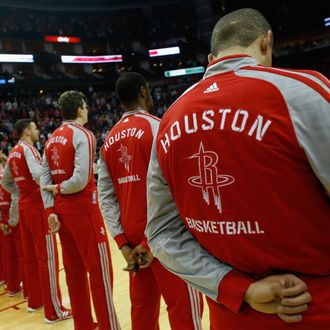 Members of the Houston Rockets stand during the National Anthem before the game against the Los Angeles Clippers at the Toyota Center on March 29, 2014 in Houston, Texas.