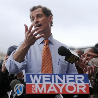 Anthony Weiner (C) speaks to the media after courting voters outside a Harlem subway station a day after announcing he will enter the New York mayoral race on May 23, 2013 in New York City. Weiner is joining the Democratic race to succeed three-term Mayor Michael Bloomberg after he was forced to resign from Congress in 2011 following the revelation of sexually explicit online behavior.
