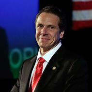 22 May 2014, Huntington, Long Island, New York State, USA --- New York Gov. Andrew Cuomo listens to applause as he's introduced as his party's nominee for re-election, at the state's Democratic Convention, in Melville, N.Y., Thursday, May 22, 2014. In a speech accepting his party's nomination, Cuomo cited his work to pass gay marriage and gun control and called Republicans the party of negativity and fear. (AP Photo/Richard Drew) --- Image by ? Richard Drew/AP/Corbis