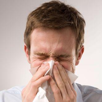 Man Blowing Nose .