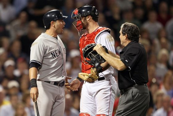 BOSTON, MA - AUGUST 30:  Francisco Cervelli #17 of the New York Yankees reacts after he is hit by a pitch as catcher Jarrod Saltalamacchia #39 of the Boston Red Sox and home plate umpire Ed Rapuano try to calm Cervelli down on August 30, 2011 at Fenway Park in Boston, Massachusetts.  (Photo by Elsa/Getty Images)