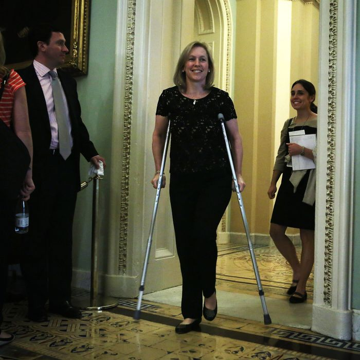 U.S. Sen. Kirsten Gillibrand (D-NY) walks on crutches as she arrives at the Senate Democratic Policy luncheon at the U.S. Capitol October 15, 2013 on Capitol Hill in Washington, DC. The U.S. government shutdown is entering its 15th day as the U.S. Senate and House of Representatives remain gridlocked on funding the federal government.