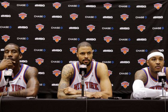 From left, New York Knicks forward Amare Stoudemire, center Tyson Chandler, and forward Carmelo Anthony address members of the media during a press conference debuting the NBA basketball team's new front court at the team's training facility in Greenburgh, N.Y., Monday, Dec. 12, 2011. (AP Photo/Kathy Willens)