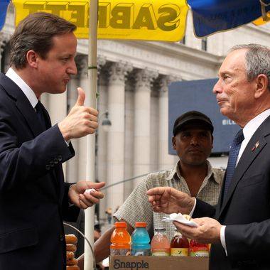 NEW YORK - JULY 21:  British Prime Minister David Cameron (L) gives a thumbs up after eating a hot dog with New York City Mayor Michael Bloomberg outside Penn Station on July 21, 2010 in New York City. Cameron will conclude his two-day visit to the U.S. by conducting meetings with Bloomberg and UN Sec. General Ban Ki-moon in New York.  (Photo by Oli Scarff/Getty Images) *** Local Caption *** David Cameron;Michael Bloomberg
