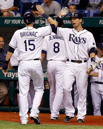 ST. PETERSBURG, FL - SEPTEMBER 26: Infielder Ben Zobrist #18 of the Tampa Bay Rays congratulates Reid Brignac #15 after he scores against the New York Yankees during the game at Tropicana Field on September 26, 2011 in St. Petersburg, Florida. (Photo by J. Meric/Getty Images)