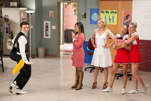 Kurt (Chris Colfer, L) interrupts a performance by Tina (Jenna Ushkowitz, second from L), Quinn (Dianna Agron, third from L), Santana (Naya Rivera, fourth from L) and Brittany (Heather Morris, R).