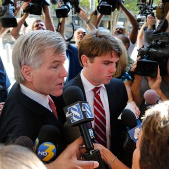 Former Virginia Gov. Bob McDonnell arrives at Federal Court with his son, Bobby, right, for the third day of jury deliberations in his corruption trial in Richmond, Va., Thursday, Sept. 4, 2014. (AP Photo/Steve Helber)